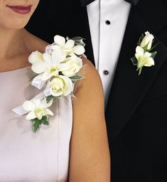 White orchid and rose corsage and boutonniere.