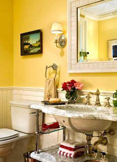 yellow paint and marble sink vanity