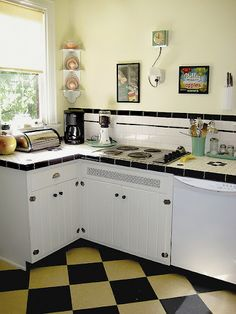 Vintage tile countertop with subway tile backsplash with liner tile and black box edging or Box cap edging.