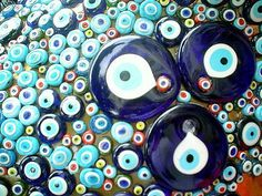 "These jewels represent an eye, to ward off the curse of ""the evil eye"" in many Mediterranean cultures. The eye jewel is usually paired with the Hand of Hamsa which acts as a protective symbol against evil. The colors are always blue to represent the eye."