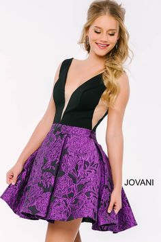 Dropping it low in this #jovani 42788 floral printed plunging neckline dress.