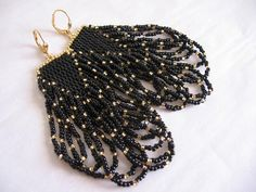 These pretty bead woven earrings are handmade with both delica & rocaille seed beads in black & golden.  They measure 3-1/2 long which includes the plated leverback earwires