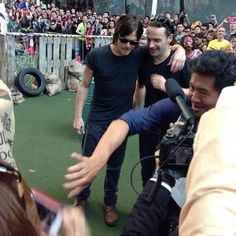 NORMAN & ANDREW ~ THIS PHOTO MAKES ME IMAGINE HOW STRANGE & STRESSFUL IT MUST BE TO BE SO SOUGHT AFTER, THE CROWDS THAT SURGE TO GET ONE GLIMPSE OF YOU.  STARDOM IS GREAT BUT THE CELEBRITIES PAY A PRICE.  BLESS THEM.