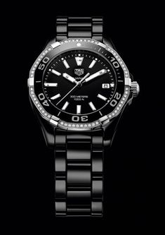 The @tagheuer Aquaracer Lady watch boasts 300-meter water-resistance, a rotating divers' bezel, screwed crown and screwed caseback with a divers' helmet engraving, luminous markers, and nonreflective sapphire crystals. Shown above is the black model with a diamond-set black ceramic bezel on a black ceramic bracelet.  More @ http://www.watchtime.com/wristwatch-industry-news/watches/5-new-tag-heuer-aquaracers-bigger-cases-all-ceramics-for-ladies/ #watchtime #chronograph #divewatch