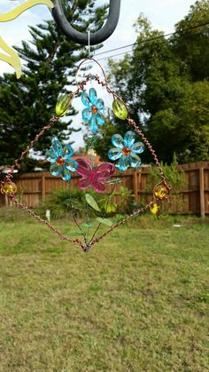 Check out this item in my Etsy shop https://www.etsy.com/listing/216138572/floral-suncatcher