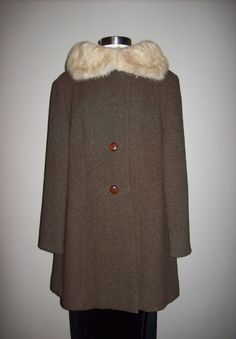 I had a coat similar to this...collar and fabric were the same shade, however.  College and early marriage...