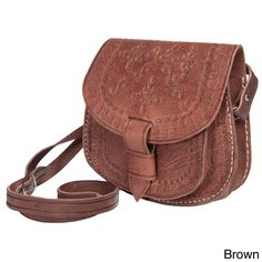 Hand-embossed detailing adds character and charm to this handmade Moroccan cross-body shoulder bag. Featuring a main compartment and under-flap front pocket, tongue and loop closure and adjustable strap, this bag is perfect for toting your essentials.