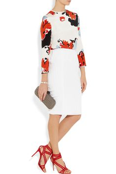 White skirt, bold print top, complete with red heels