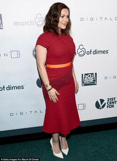 Sizzling: The former Who's The Boss star looked fantastic in a figure-hugging crimson red ...