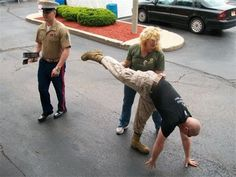 Owner Laurie Milbourn helping a marine into a yoga pose. Catch one of Laurie's classes in downtown Geneva at Going to My Happy Place Yoga.