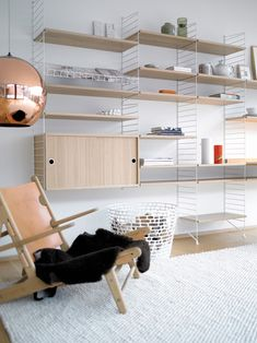 Vitsoe is my favourite shelving system but String is pretty great too.