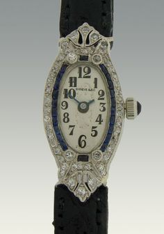 Vintage Swiss ladies diamond and sapphire wrist watch by Shreve & Co in platinum oval case set with diamonds and sapphires, restored original dial and 17 jewel movement, circa 1930.