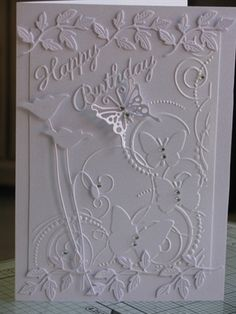 hand crafted birthday card ...white on white by: linda-s ... embossing folder texture and die cuts ... flowers, leaves and butterflies ...
