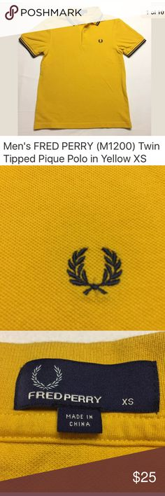 """FRED PERRY (M1200) Twin Tipped Polo in Yellow XS Authentic FRED PERRY (M1200) Twin Tipped Polo in Yellow with Blue and Black trim as pictured. Fantastic preowned condition- NO rips, holes, snags or stains. No missing or damaged buttons. Laundered and ready to wear. •100% Cotton •Straight Hem Size on tag: XS  Measures: •17"""" from armpit to armpit •23.5"""" from the bottom of the collar to the hem Fred Perry Shirts Polos"""