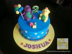 Barney & friend cake.  Blue cake topped with handmade barney holding balloons, his yellow friend, number 2 and presents. Stars on side of cake.