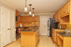 How+to+Paint+Kitchen+Cabinets+Without+Sandi ng+or+Priming This is such a nice kitchen cabinet make over and with out sanding! check out the after picture