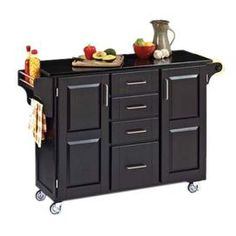 """Granite-topped kitchen cart in black with two doors and four drawers.   Product:  Kitchen cartConstruction Material: Hardwood and graniteColor: Black Features:  Concealed storageAdjustable spice caddy and towel barHeavy duty casters, with front casters locking Dimensions: 35.5"""" H x 48"""" W x 17.75"""" DCleaning and Care: Clean with damp cloth"""