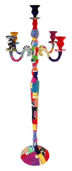 The Floor Candle Stick    The floor standing Candlestick to order wrapped in single colour velvets or patch work, by the nature of the patchworked process no two pieces are exactly the same. Fabrics used include woven silks, velvets and printed and woven cottons