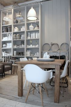 modern gray white cream wood styling of the dining room or craft room / office bookcase shelves