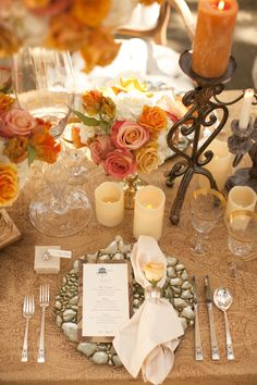 table setting with orange, champagne and tan flowers and candles | Zenadia Designs