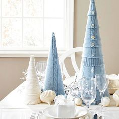 Create a charming wintry look on your dining table with these woolen tabletop Christmas trees made from gently worn or cast-off sweaters.