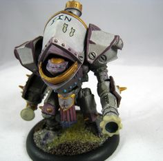 A Protectorate of Menoth Reckoner with the nose art (SIN + 2 bombshell silhouettes) shown on the top.