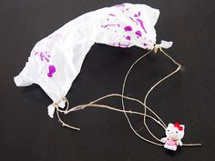 """Paper Parachutes! give their toys """"wings"""" by creating parachutes using just napkins and strings. Talk about a fantastic way to teach kids about gravity and weight!"""