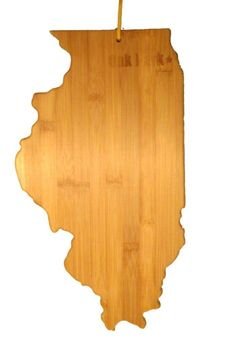 """A perfect housewarming gift this board is sure to be a hit to any lover of Oak Park Illinois! Give the gift of hometown pride with this Illinois shaped bamboo cutting board. Oak Park is home to Ernest Hemingway and Betty White and of course land of Frank Llyod homes.    Cutting board is in the shape of Illinois with """"Oak Park"""" laser cut in top right corner of the state.     1"""" thick 16 1/2"""" high    Do not put in dishwasher simply oil the board and air dry as needed. Oakpark Bamboo Board by…"""