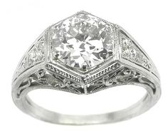 This is by far, the most beautiful ring i have ever found. This is exactly what I dream of being given one day! Edwardian style, with lily filigree.