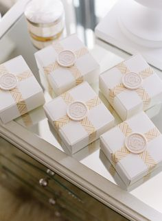 Rosemary Beach Wedding, bridesmaid gift box idea, gift box wax seal, wedding monogram wax seal. Boxes from Paper Source.