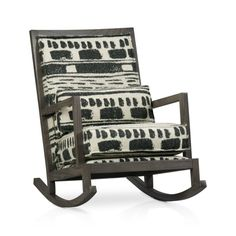 Our exclusive heirloom-quality rocker with fully upholstered back panel is handcrafted in America for generations of enjoyment.  The classic rocker frame is solid oak with a warm smoke finish, while the textural black-and-white cotton-wool fabric with exposed seams features a rustic-meets-modern abstract motif at home in cabin or condo.
