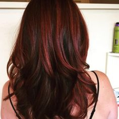 Dark red highlights in chocolate brown locks. Gorgeous. Hair by Jade from David J. Witchell Salon & Spa