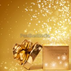 Sparkling golden Christmas background with opened gift box