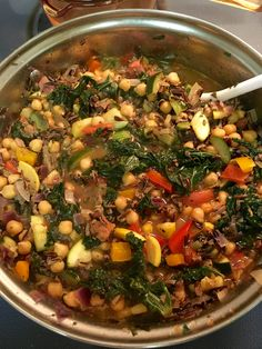 Garbanzo bean and Wild rice vegetable soup- chopped red and yellow onions, zucchini, yellow squash, red and orange bell peppers, kale, and Roma tomatoes. Spiced w/ smoked sea salt, sea salt, cayenne pepper, onion powder, basil, sweet basil, tarragon, and oregano.