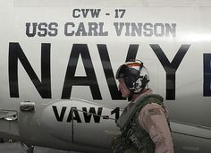 Rear Adm. Thomas K. Shannon, commander of Carrier Strike Group 1, prepares to board an E-2C Hawkeye for a flight with Carrier Airborne Early Warning Squadron (VAW) 125.