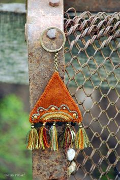 Rustic orange ethnic key chain with embroidery. Textile by Mioltu
