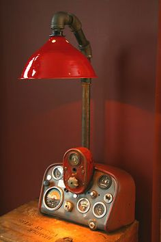 This steampunk table lamp features a Farmall Tractor dash panel which has a amp gauge that lights up with a turn of the silver switch. A Farmall 1946 Tractor dash panel. Industrial Lighting, Cool Lighting, Lampe Steampunk, Car Part Furniture, Furniture Plans, Kids Furniture, Furniture Chairs, Furniture Stores, Garden Furniture