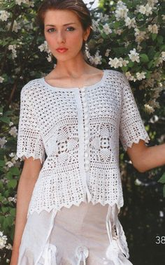 This is a beautiful crocheted blouse.  Too bad I can't read the instructions.