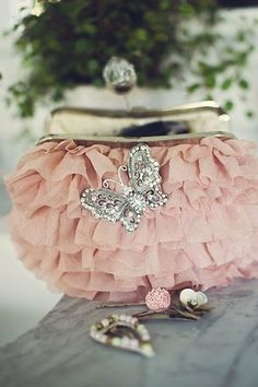 Pink evening purse with butterfly brooch