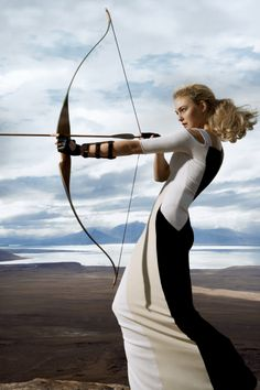 Patrick Demarchelier. Love the fashion focus of this archer photo. Can tell the model is not an archer, but it's a great photo.