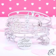 """""""It all started when a best friend gifted her the Canopy Baby Carriage charm when Bella was born. On Mother's Day years later her two children presented the Number One Mom and Mom Accent charm. On her birthday the husband gave her the Bow Charm because she was """"bow-utiful"""" to him. The """"I love you to the moon and back"""" charm reminds her of what her own mother would always say to her."""" This is one woman's #CharmStory. What's yours?"""