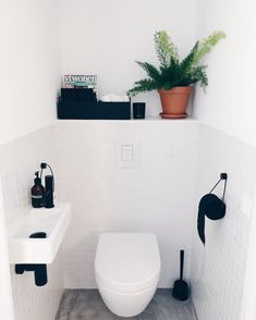 Is your home in need of a bathroom remodel? Give your bathroom design a boost with a little planning and our inspirational bathroom remodel ideas Small Toilet Room, Guest Toilet, Downstairs Toilet, Small Toilet Decor, Toilet Wall, Bad Inspiration, Bathroom Inspiration, Dark Tile Floors, Wc Decoration