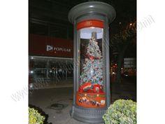 Mobiliario Urbano Espectacular | SP Integrales Publicidad de Caja Roja de Nestle dentro de columna publicitaria