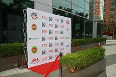 8'x10' Polyester Stretch Fabric with Red Carpet, Stanchions & Red Velvet Ropes for Hoboken, NJ Charity Event.