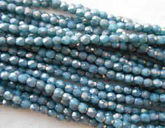 Fifty 3mm Opaque Turquoise Moon Dust Czech glass firepolished, faceted round beads with a golden finish, C4550