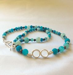 A personal favorite from my Etsy shop https://www.etsy.com/listing/254817857/aqua-beaded-necklace-infinity-necklace