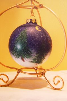 My handpainted ornament with pine trees on a snowy winter's eve