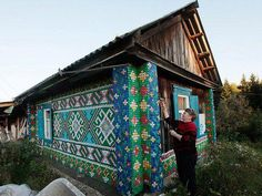 Russian woman covers house in 30,000 bottle caps. - Imgur - now this is recycling at its finest.