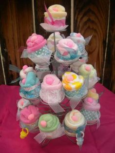 Babg clothes made to look like cupcakes on stand