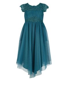 Our Odette maxi dress for girls will ensure she wows at every special occasion. Fashioned from shimmering navy net it features foil-printed tonal lace panels at the yoke and waist, matt satin ties and a handkerchief hem. Fully lined with back zip fastening.